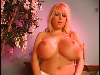 naughty blonde woman takes undressed and uses her