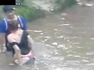 desperate lady copulates a man in the river