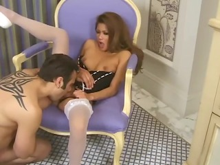 woman into a bustier and colorless stockings