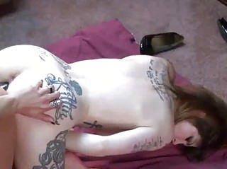 tattooed indigo shares a dong with a busty lady