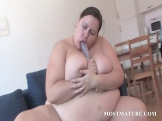 grown-up bbw works her boobs with a dildo