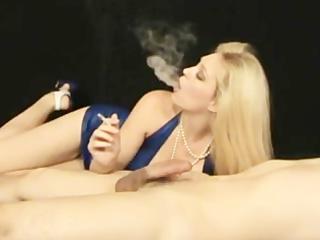 blond woman smoking & licking penis