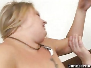 large chubby woman piercing uneasy on the couch
