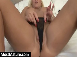 blonde lady screwing a light blue porn vibrator