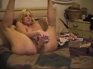 cougar blondie sticks a monstrous fuck toy and