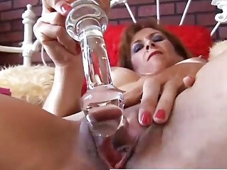 awesome cougar redhead is feeling busty