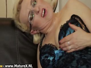 busty mature is rubbing her aperture