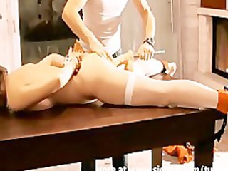 tied up and pierced with a huge sex device